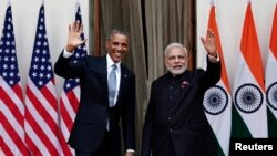 U.S. President Barack Obama and India's Prime Minister Narendra Modi, right, wave during a photo opportunity ahead of their meeting at Hyderabad House, New Delhi, Jan. 25, 2015.