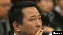 前矿业大亨刘汉过去在一次会议上