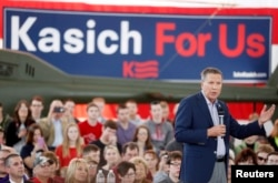 FILE - Republican U.S. presidential candidate Gov. John Kasich (R-OH) speaks at a campaign rally at the MAPS Air Museum in North Canton, Ohio, March 14, 2016.