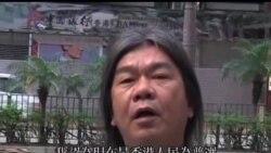 2013-10-01 美國之音視頻新聞: 中國新領導人冒雨慶祝國慶 香港民眾抬紙棺材抗議