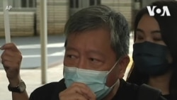 香港26名民主人士因参加六四烛光守夜活动被控罪出庭