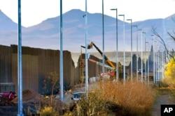 FILE - Crews construct a section of border wall in San Bernardino National Wildlife Refuge in Douglas, Ariz., Dec. 8, 2020.