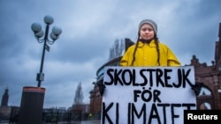 "In this file photo, Sweden's Greta Thunberg, 15, holds a sign reading ""School strike for the climate"" during a demonstration against climate change outside the Swedish parliament in Stockholm, Sweden, on November 30, 2018."