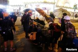 Anti-extradition bill protesters set up a roadblock at Tsim Sha Tsui neighborhood in Hong Kong, Aug. 10, 2019.