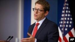 Juru bicara Gedung Putih Jay Carney berbicara pada wartawan. (AP/Charles Dharapak)