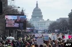 FILE: Participants take part in the March for Our Lives Rally in Washington, DC on March 24, 2018.
