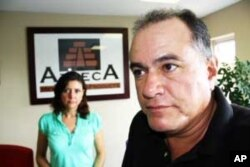 Hector(in forground) and Gaby Agrazi in the reception area of their Mexican food company near Johannesburg