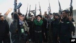 اعضای یکی از گروه های شبه نظامی شیعه در عراق که در جریان جنگ با داعش کمک نیروی قدس سپاه پاسداران ایجاد شدند.