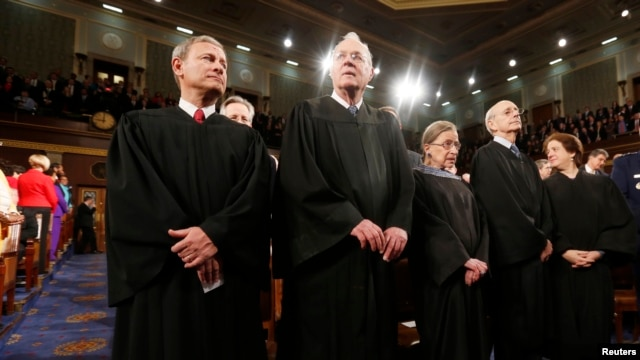 U.S. Supreme Court Chief Justice John Roberts (L) stands with fellow Justices Anthony Kennedy (2nd from L), Ruth Bader Ginsburg, Stephen Breyer and Elena Kagan (R) prior to President Barack Obama's State of the Union speech on Capitol Hill in Washington, January 28, 2014