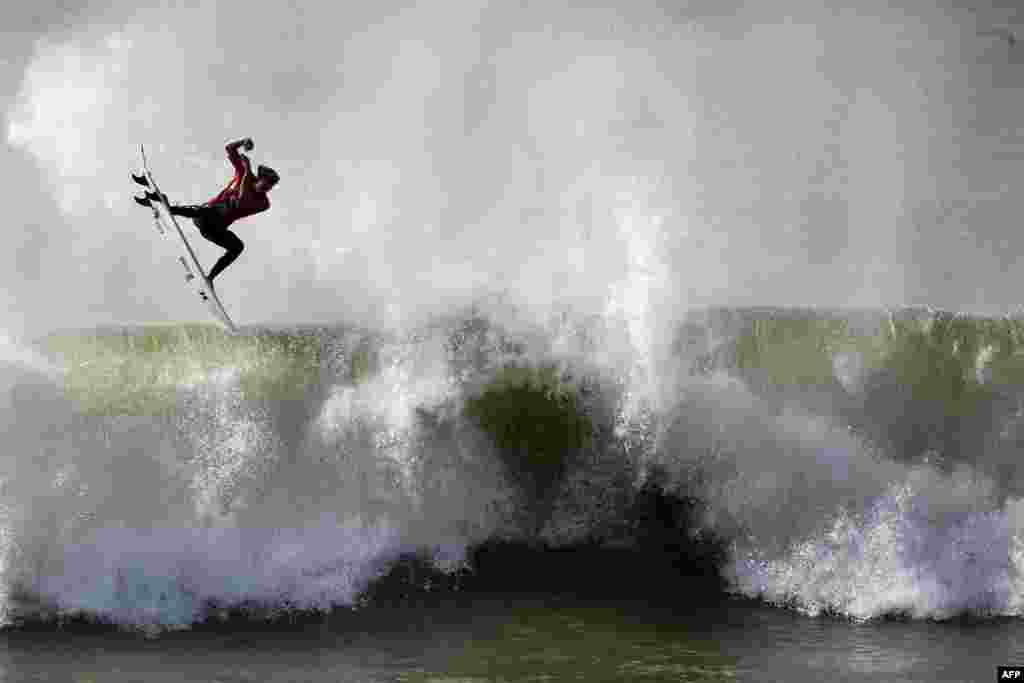 Hawaiian surfer John John Florence competes during the quarter-final heat of the Moche Rip Curl Pro Portugal at Supertubos Beach in Peniche, Portugal.