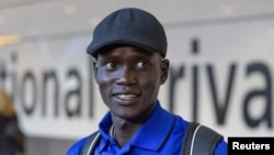 Marathon runner Guor Mading Maker (formerly Guor Marial) arrives at Heathrow Airport for the London 2012 Olympic Games, August 3, 2012. Maker's dream to run for South Sudan at the 2016 games in Rio de Janeiro suffered a blow this month when the South Sudan Athletics Federation suspended him.