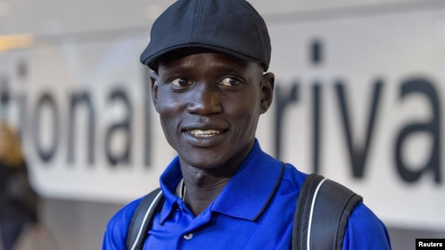 Marathon runner Guor Marial arrives at Heathrow Airport for the London 2012 Olympic Games, August 3, 2012.