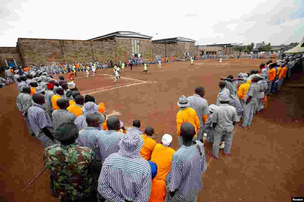 Kenyan prisoners watch a mock World Cup soccer match between Russia and Saudi Arabia, as part of a month-long soccer tournament involving eight prison teams at the Kamiti Maximum Prison, Kenya's largest prison facility, near Nairobi, Kenya, June 14, 2018.