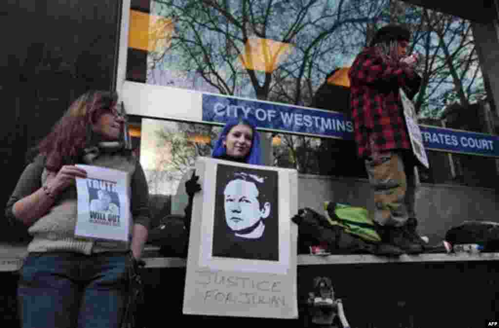 Supporters of Wikileaks founder Julian Assange, gather outside the City of Westminster Magistrates Court in London where Julian Assange's case was heard, Tuesday, Dec. 7, 2010. Julian Assange was jailed Tuesday after the WikiLeaks founder told a London co