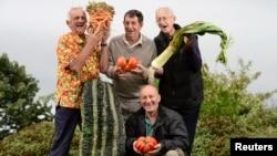 In this 2013 photo, these men pose with their prize-winning vegetables.