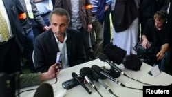 FILE - Tariq Ramadan talks to the media after a conference at the Er-Rahma mosque in Nantes, western France, April 25, 2010.