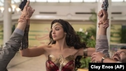 "FILE - This image released by Warner Bros. Entertainment shows Gal Gadot in a scene from ""Wonder Woman 1984."" (Clay Enos/Warner Bros. Entertainment via AP)"