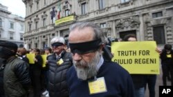 Amnesty International activists stage a flash mob asking for truth about the death of Italian student Guido Regeni, outside Milan's city hall, Italy, April 24, 2016. Egyptian officials have blamed five men for Giulio Regeni's death, but witnesses intervie