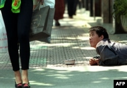 資料照:上海街頭的一名殘疾乞討者