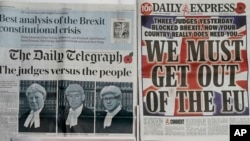 Some of the front pages of Britain's newspapers after the High Court determined that MPs must have a say on triggering Article 50 to begin the UK's exit from the European Union, in London, Nov. 4, 2016.