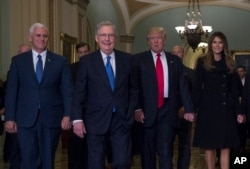 President-elect Donald Trump, his wife Melania, Vice President-elect Mike Pence and Senate Majority Leader Mitch McConnell of Kentucky walk on Capitol Hill in Washington, Nov. 10, 2016.