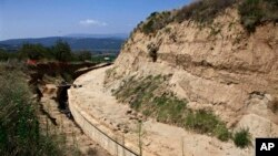 Partial view of the site where archaeologists are excavating an ancient mound in Amphipolis, northern Greece, Aug. 12, 2014.