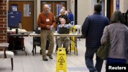 Voters arrive to cast their ballots in the U.S. Republican presidential primary at a polling station at Dreher High School in Columbia, S.C., Feb. 20, 2016.