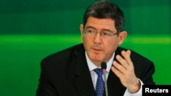 FILE - Joaquim Levy gestures during a news conference in Brasilia, Nov. 27, 2014.