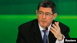 FILE - Brazil's incoming finance minister, banker Joaquim Levy gestures during a news conference in Brasilia, Nov. 27, 2014.