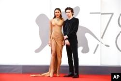 """Zendaya dan Timothee Chalamet di acara karpet merah film """"Dune"""" sebagai bagian dari festival film Venice 2021 di Italia (dok: Joel C Ryan/Invision/AP)"""