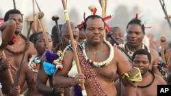 FILE - In this Sept. 3, 2012, photo, Eswatini's King Mswati III, front, dances during a Reed Dance in Mbabane.