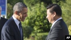 U.S. President Barack Obama, left, and China's President Xi Jinping, right, shake hands before their bilateral meeting at the G20 Summit, Sept. 6, 2013 in St. Petersburg, Russia.
