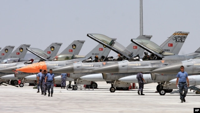 FILE - Dozens of Turkish F-16 jets prepare to take off during Anatolian Eagle exercise at 3rd Main Jet Air Base near the central Anatolian city of Konya, June 15, 2009.