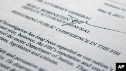 "The letter from Deputy Attorney General Rod Rosenstein titled ""Restoring Public Confidence in the FBI"" is photographed in Washington, May 9, 2017."