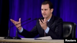 15일 바샤르 알 아사드 시리아 대통령이 다마스쿠스 시에서 열린 중앙변호사협회 회의에서 연설하고 있다.