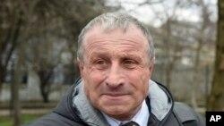 FILE - Mykola Semena speaks outside a court in Simferopol, Crimea, March 20, 2017.