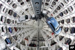 FILE - Volkswagen cars are presented to media inside a delivery tower prior to the company's annual press conference in Wolfburg, Germany, April 28, 2016.