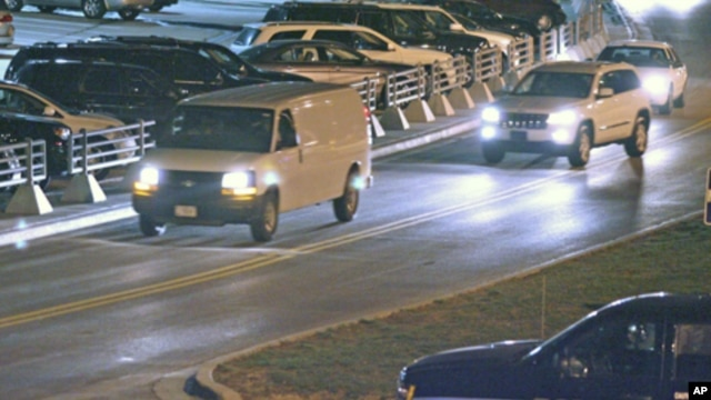 A white van, believed to be transporting Staff Sgt. Robert Bales, leaves Kansas City International Airport Friday, March 16, 2012, in Kansas City, Mo.