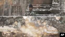 A Cambodian army soldier sits at damaged Cambodia's 11th century Hindu Preah Vihear temple, file photo.