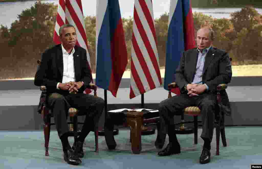 U.S. President Barack Obama (L) meets with Russian President Vladimir Putin during the G8 Summit at Lough Erne in Enniskillen, Northern Ireland, June 17, 2013.