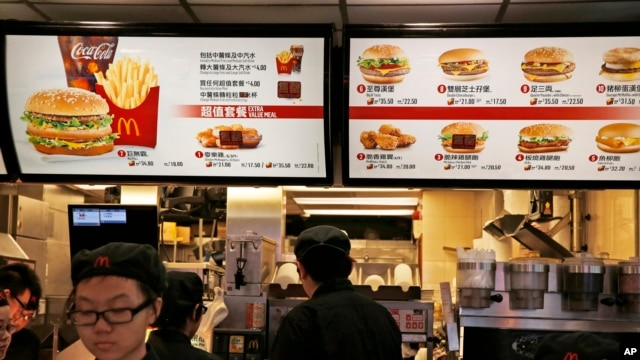 McDonald's Hong Kong restaurants have taken chicken nuggets and chicken filet burgers off the menu following accusations of selling expired meat. A menu as of July 25, 2014.