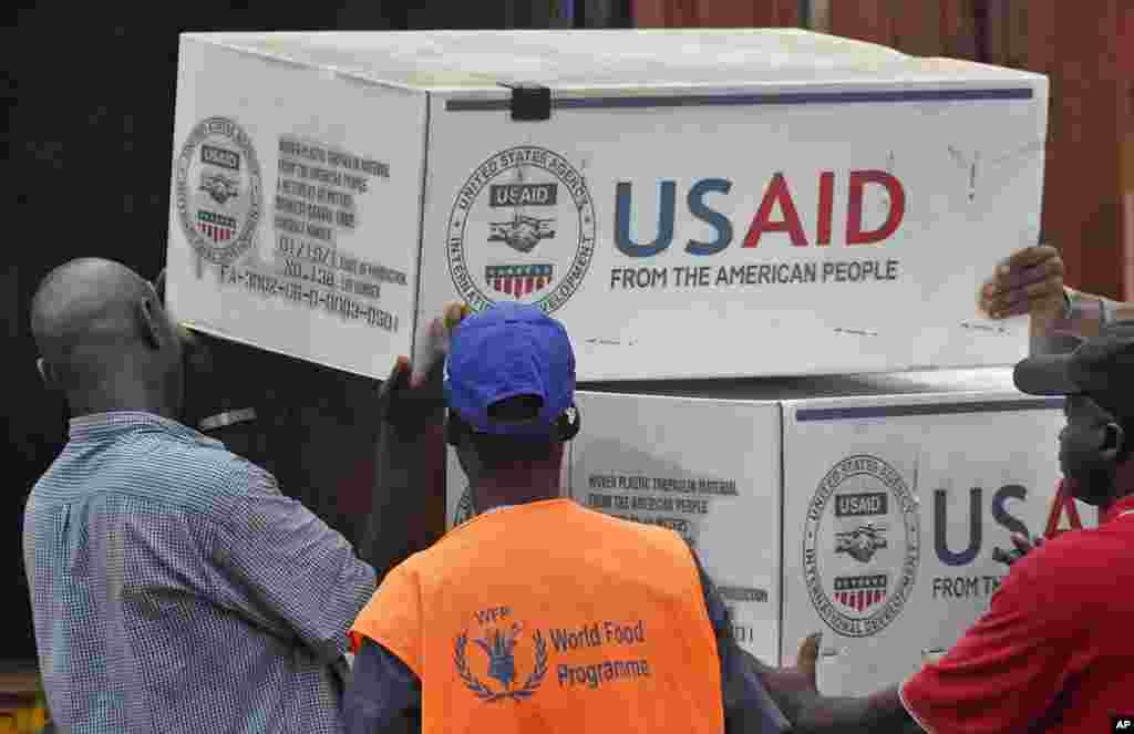 American Aid goods are loaded onto a truck after arriving by airplane, to be used in the fight against the Ebola virus spreading in the city of Monrovia, Liberia, Aug. 24, 2014.