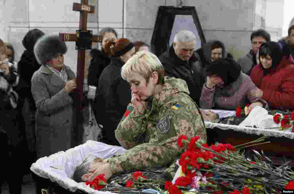 "People mourn during a funeral ceremony for Ruslan Boburov and Vadym Zherebylo, members of the self-defense battalion ""Aydar,"" who were killed while fighting in eastern Ukraine, Feb. 2, 2015."