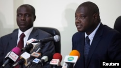 Mbacke Fall (R), head of the Extraordinary African Chambers, a special court set up this year by Senegalese authorities in agreement with the African Union, speaks to journalists at a news conference in Dakar, July 1, 2013.