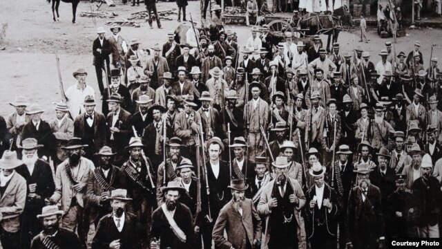 An old photo of an Irish brigade that joined Boers against the English in 1900 proudly hangs in the SouthWest Province brewhouse of Dirk van Tonder. (Photo Credit: Darren Taylor)