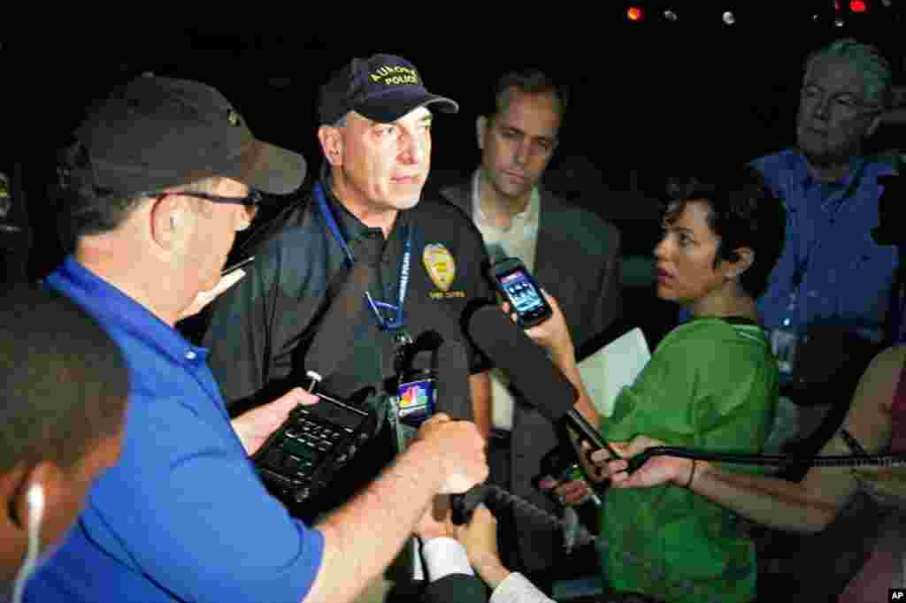 Aurora Police Chief Daniel Oates talks to media at Aurora Mall where as many as 14 people were killed and many injured at a shooting at the Century 16 movie theater, July 20, 2012.