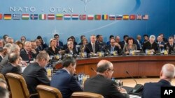 FILE - NATO defense ministers are seated during a meeting of the North Atlantic Council Defense Ministers session at NATO headquarters in Brussels, Oct. 27, 2016. On Tuesday they will face a busy agenda as they meet for year-end talks.