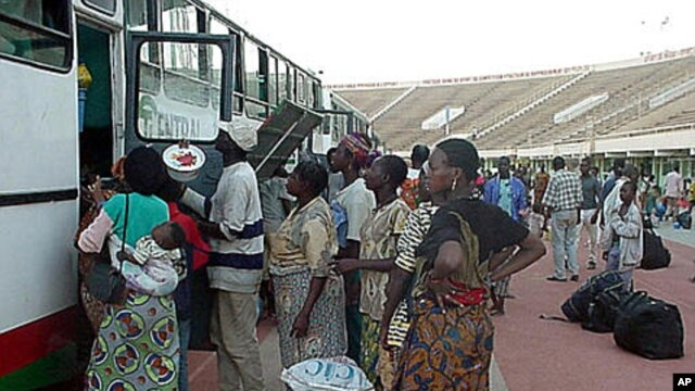 Part of millions of frightened immigrants, some Burkina Faso citizens unload their belongings at the national soccer stadium in Ouagadougou, Burkina Faso after they came home from the cocoa plantations and coffee fields of neighboring Ivory Coast (File Ph