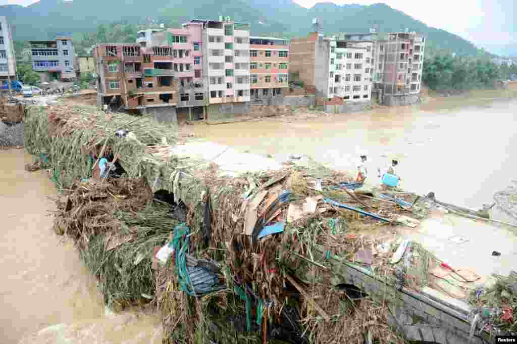 Residents walk on a bridge after Typhoon Nepartak in Fuzhou, Fujian Province, China, July 11, 2016.