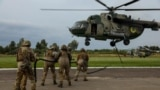 Ukrainian and Romanian soldiers practice insertion together at Rapid Trident 2021